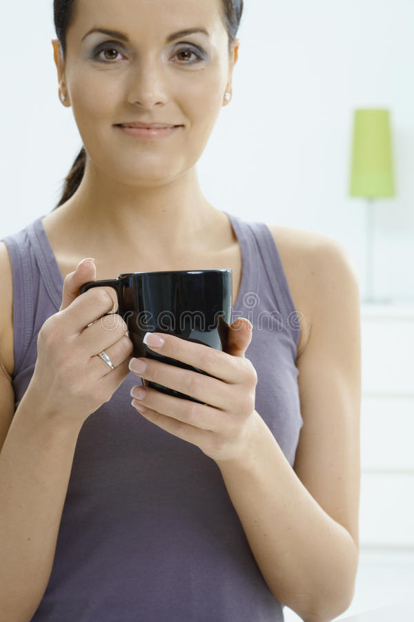 Download Woman holding coffee cup stock photo. Image of hair, attractive - 9886918