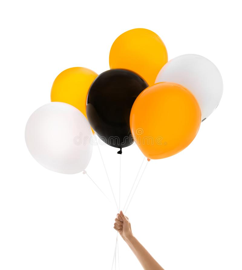 Woman holding color balloons for Halloween party on white background. Closeup stock images