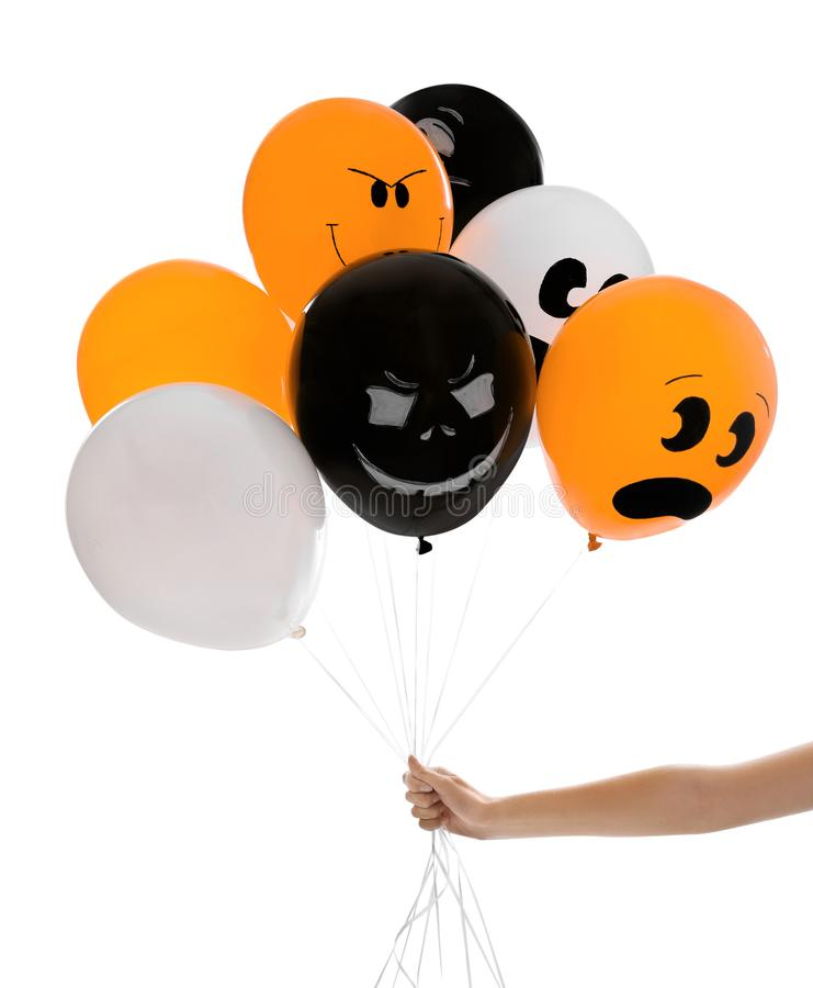 Woman holding color balloons for Halloween party on white background. Closeup royalty free stock photos