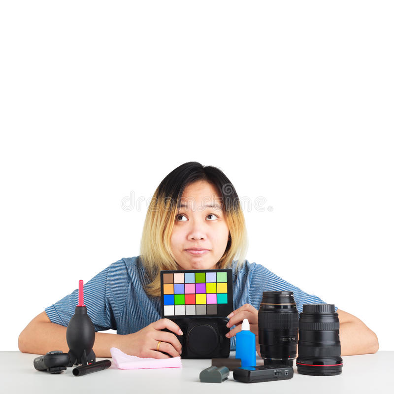 Woman holding color swatches with photography equipment on table. Asian woman holding color swatches with photography equipment on table. object isolated on stock photography