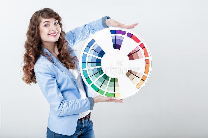 Woman holding color wheel stock photography