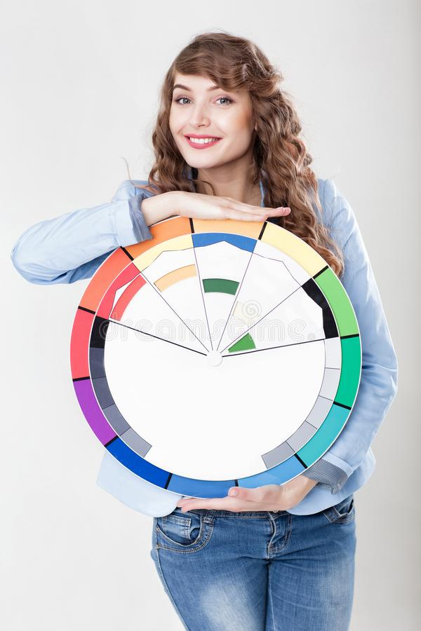Woman holding color wheel stock photos