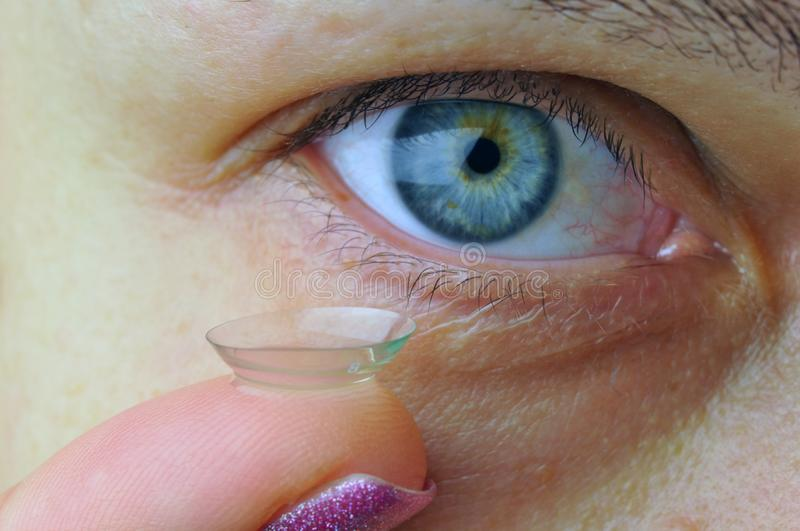 Woman eye with contact lens royalty free stock photos