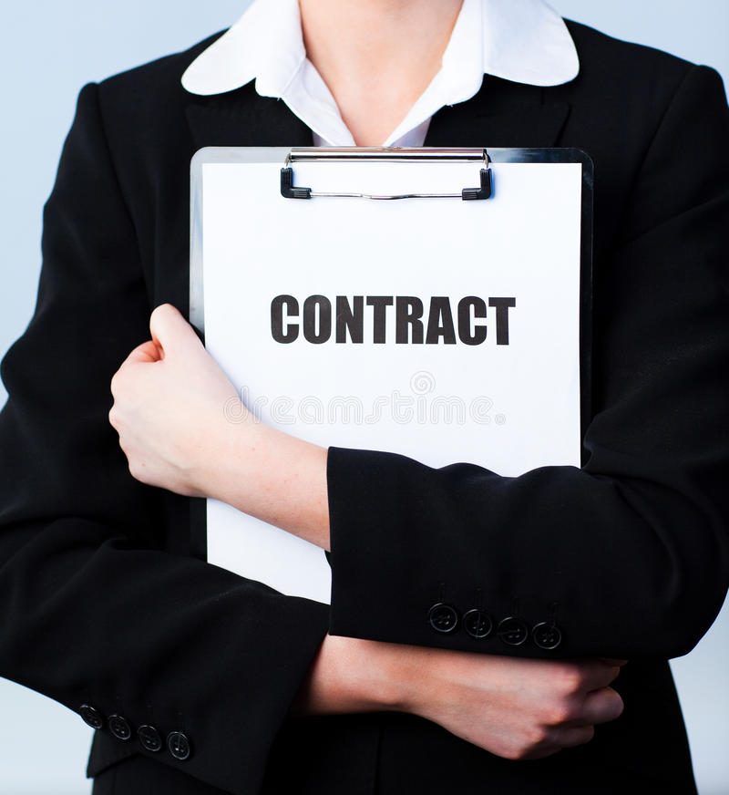 Woman holding a contract on a clipboard stock images