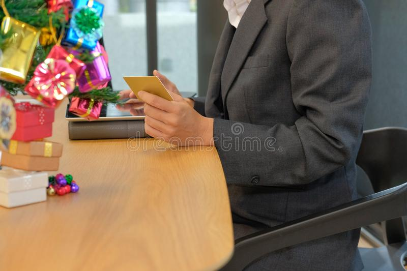 woman holding credit card using tablet for online shopping. businesswoman buying on internet during christmas holiday stock photos