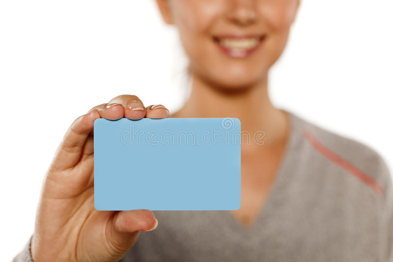 Woman holding a credit card stock photo