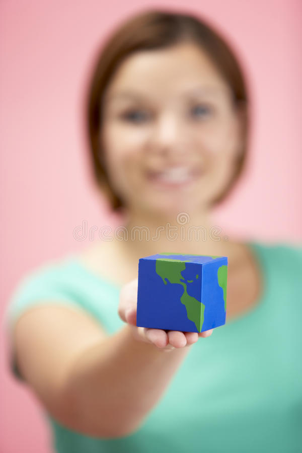 Woman Holding Cube Shaped Globe royalty free stock image