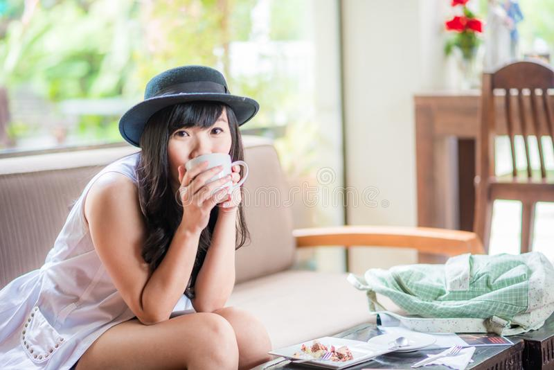 Woman holding cup of latte art coffee in her hands stock images