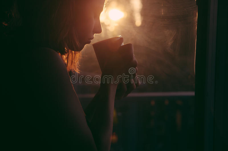 Woman Holding Cup Near Window Reflected With Sun Free Public Domain Cc0 Image