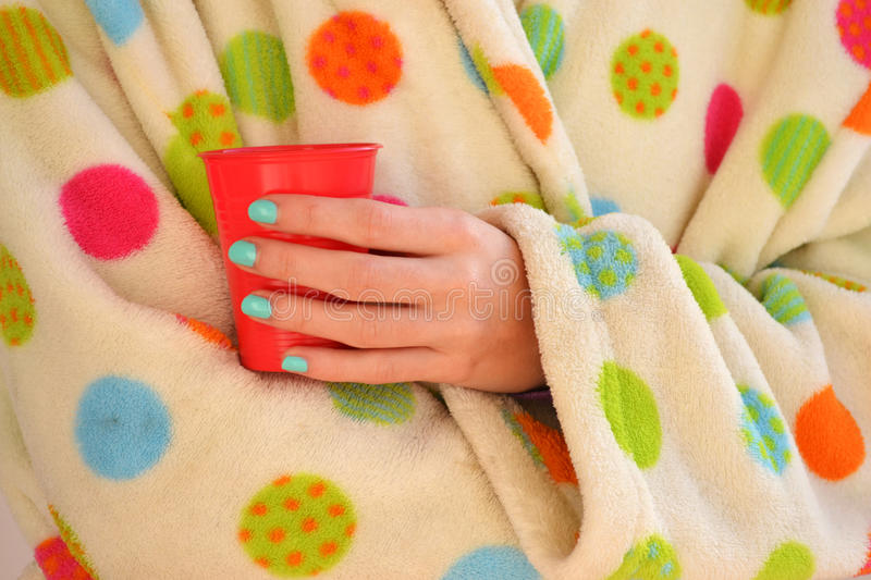 Woman holding a cup in a robe royalty free stock images