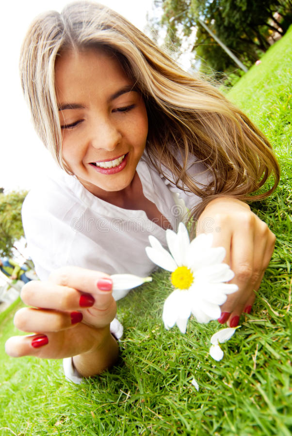 Download Woman holding a daisy stock photo. Image of love, latinamerican - 23372010
