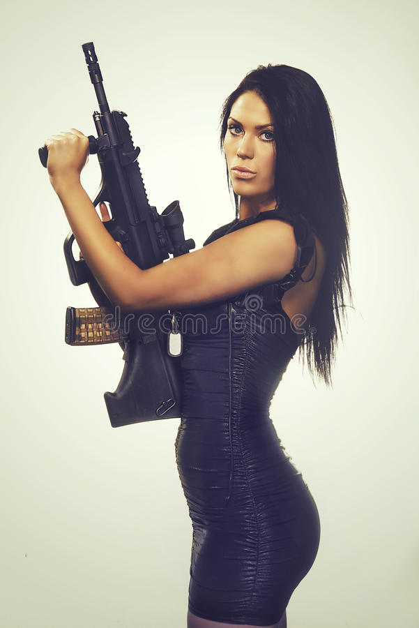 Woman holding deadly weapon stock images