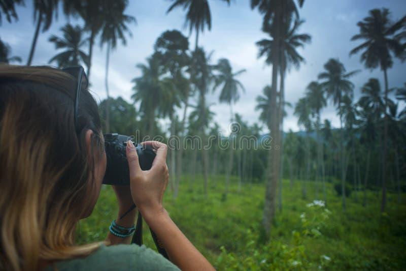 Woman Holding Dslr Camera Taking Photo stock image