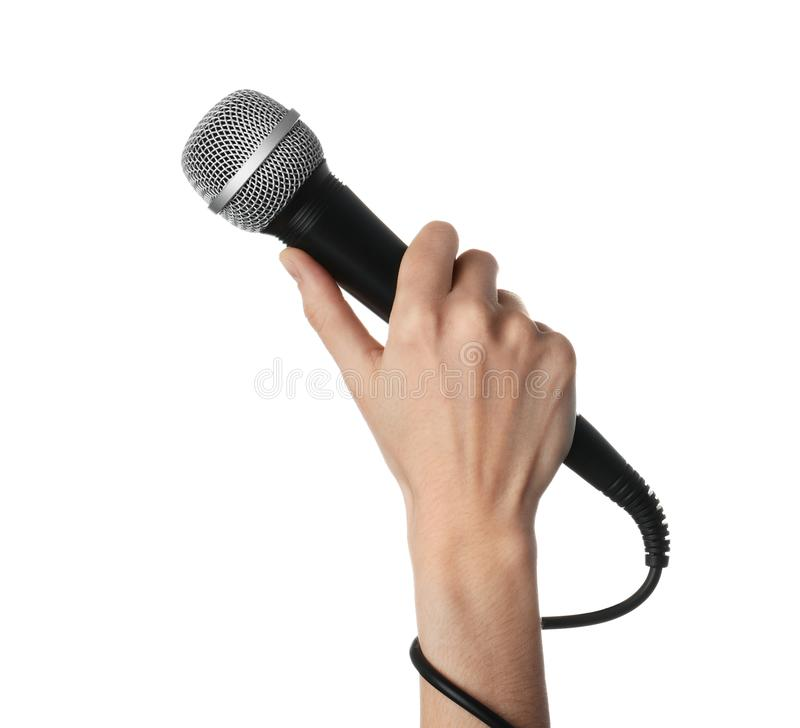 Woman holding dynamic microphone on white background stock photo