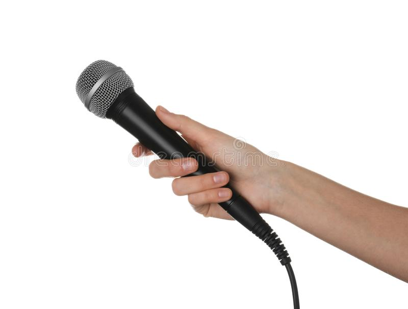 Woman holding dynamic microphone on white background royalty free stock photos