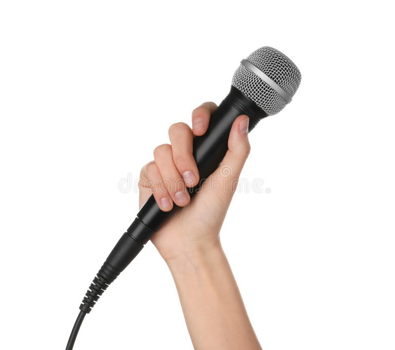 Woman holding dynamic microphone on white background stock image