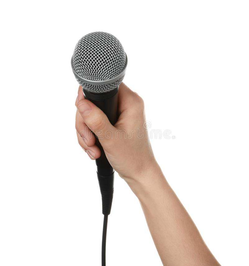 Woman holding dynamic microphone on white background stock images