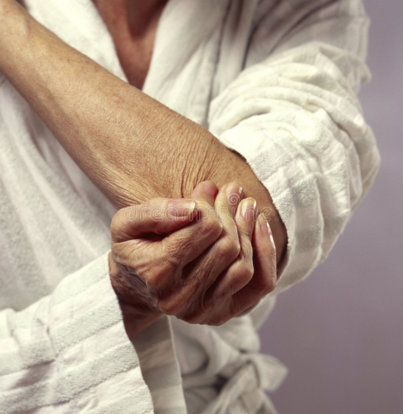 Woman holding elbow in pain royalty free stock photos