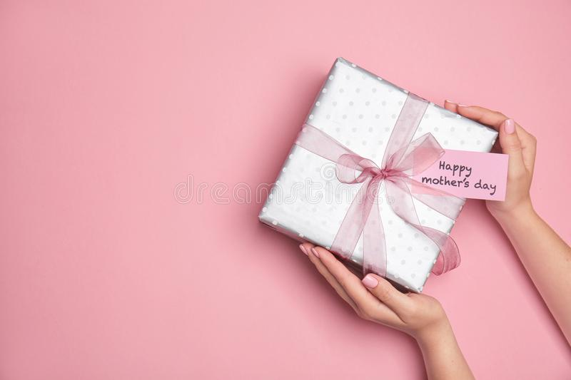 Woman holding elegant gift box for Mother`s Day royalty free stock photos