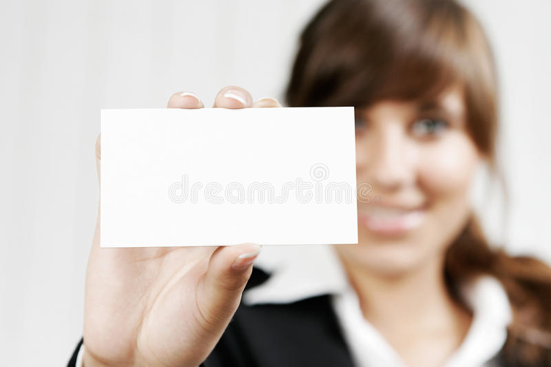 Woman holding an empty card royalty free stock photos