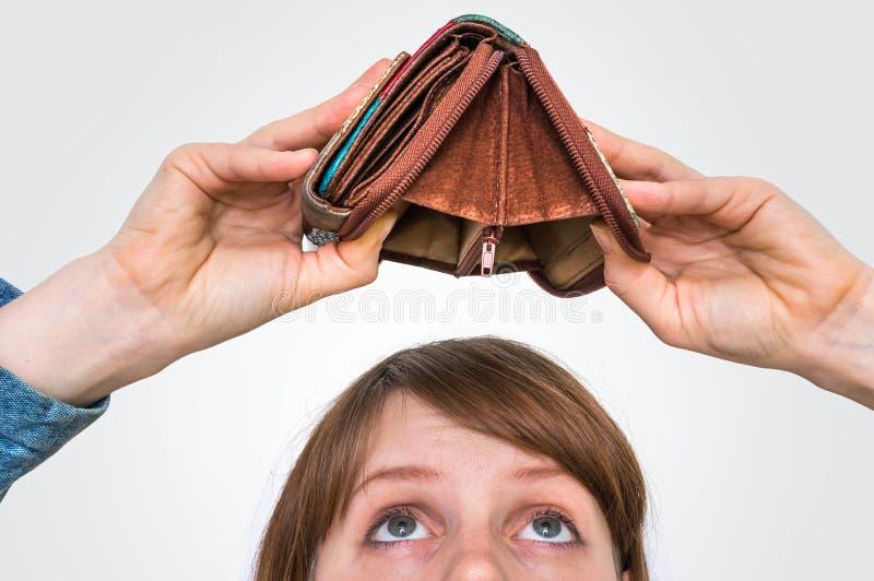 Woman holding an empty wallet, she hasn`t money stock photos