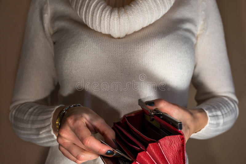 Woman holding empty wallet at night stock images