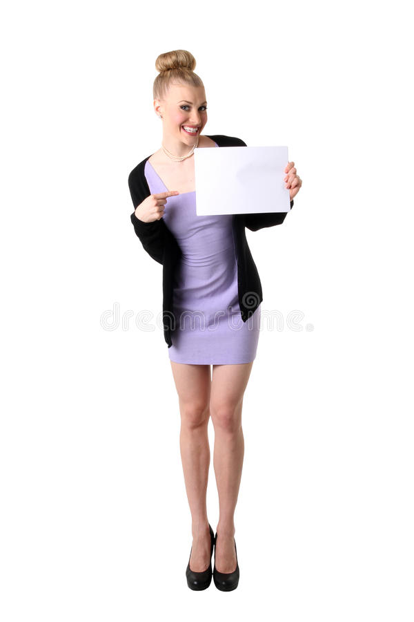 Woman holding empty white board. Full length of a young business woman holding empty white board. Isolated on a white background stock image