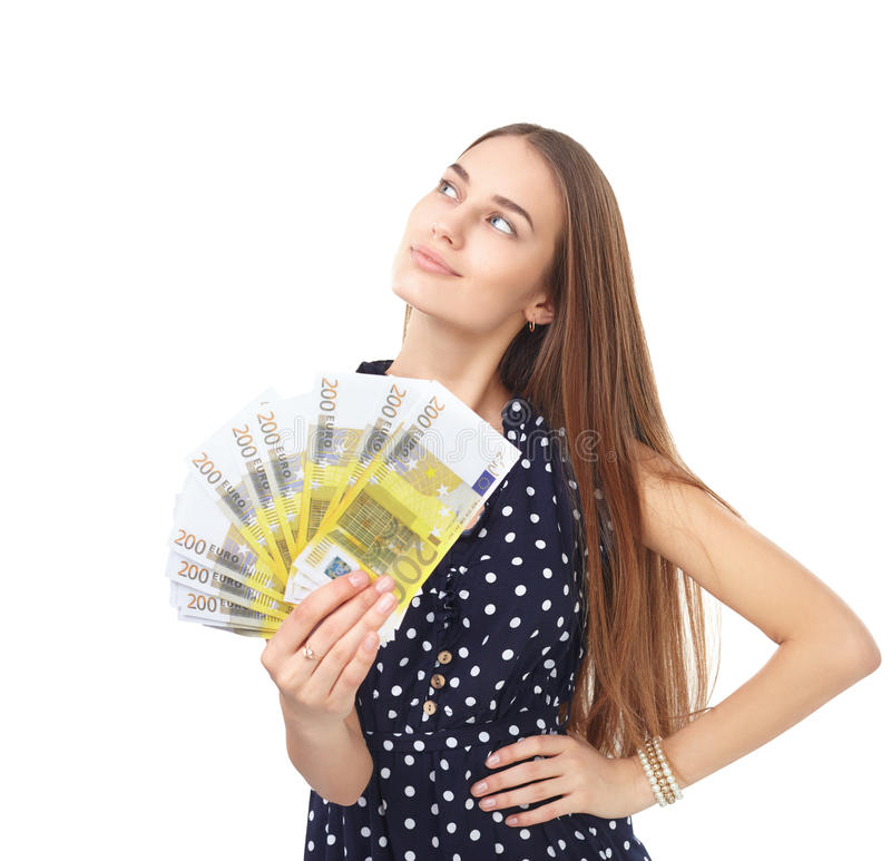 Woman holding euro money. Portrait of young beautiful woman holding euro banknotes money dreaming and looking up isolated on white background stock photography
