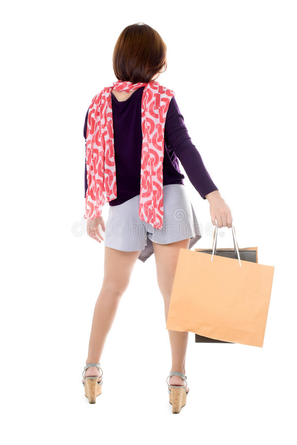 Woman holding few shopping bags stock image