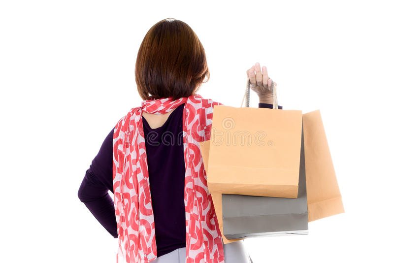 Woman holding few shopping bags stock photography