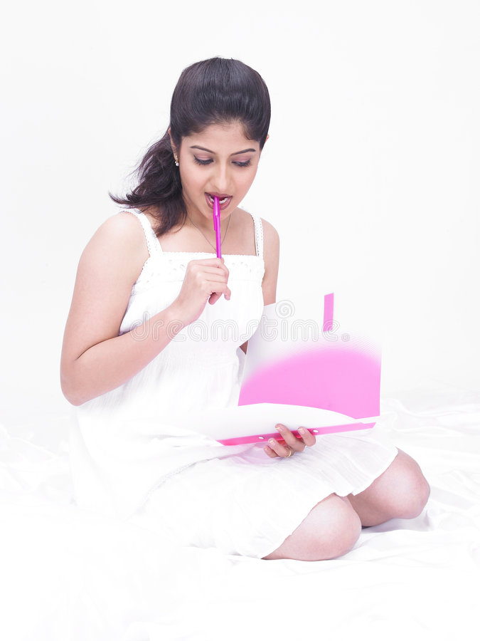 Download Woman Holding A File And Pen Stock Photo - Image of indian, housewife: 7386170