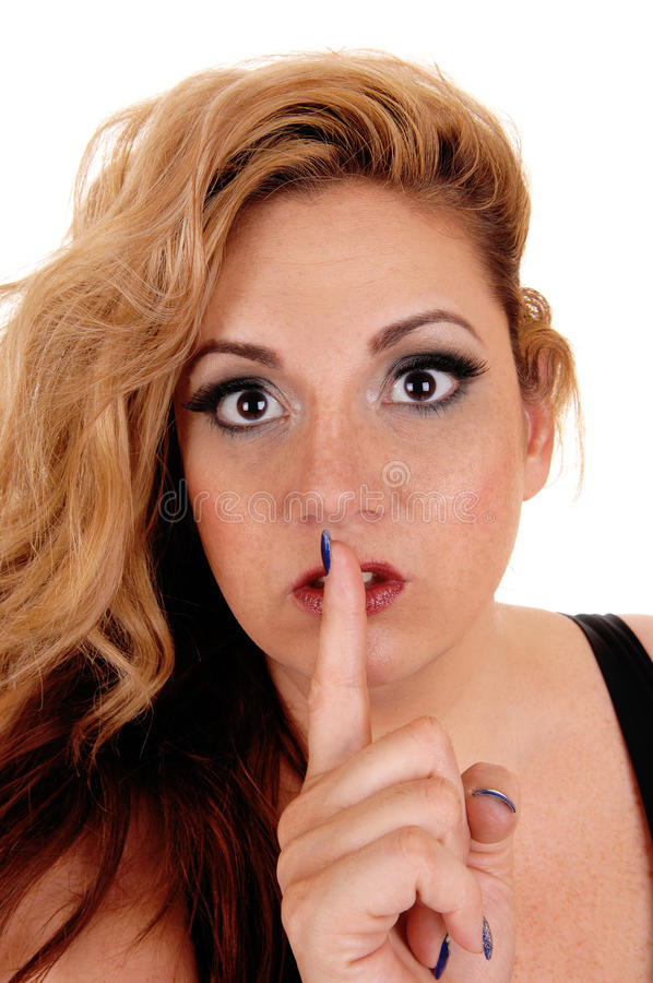 Woman holding finger on mouth. stock image