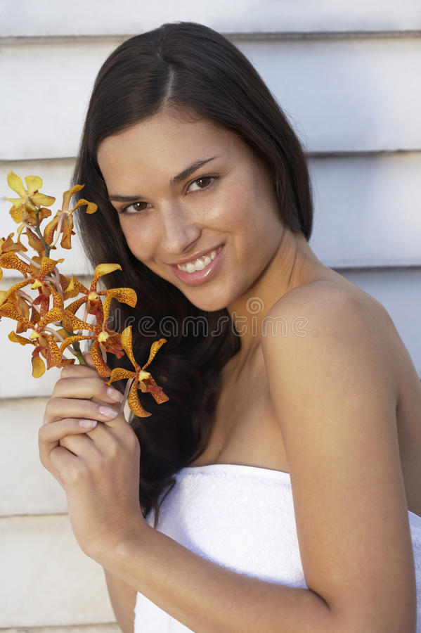 A woman holding a flower. royalty free stock image