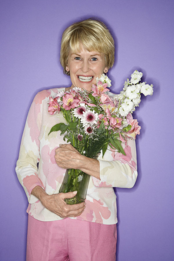 Woman holding flower bouquet. stock image