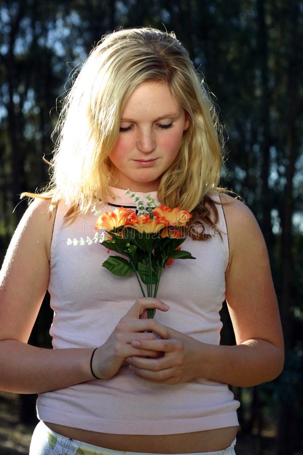 Woman Holding Flowers Free Stock Image