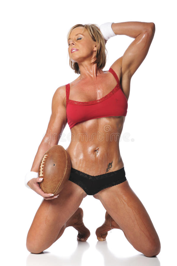 Woman holding a football stock images