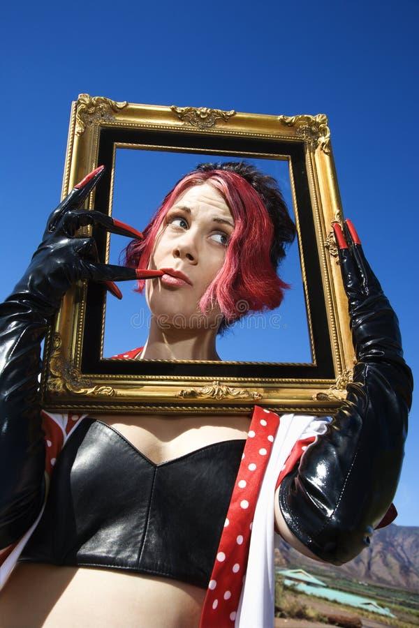 Woman holding frame. stock photos