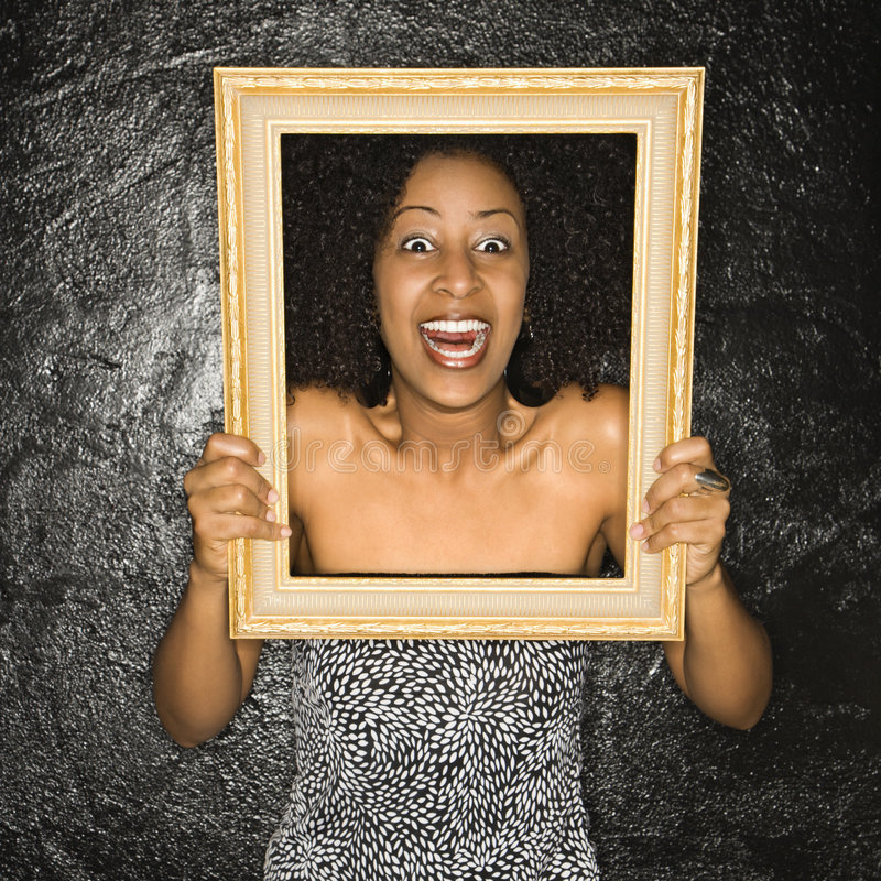 Woman holding frame. royalty free stock image