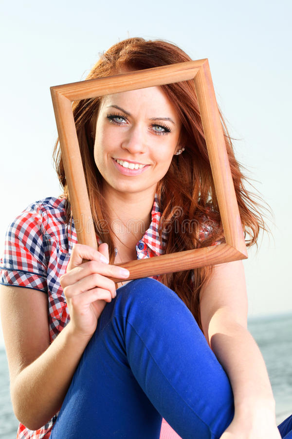 Woman Holding Frame travel concept royalty free stock photo