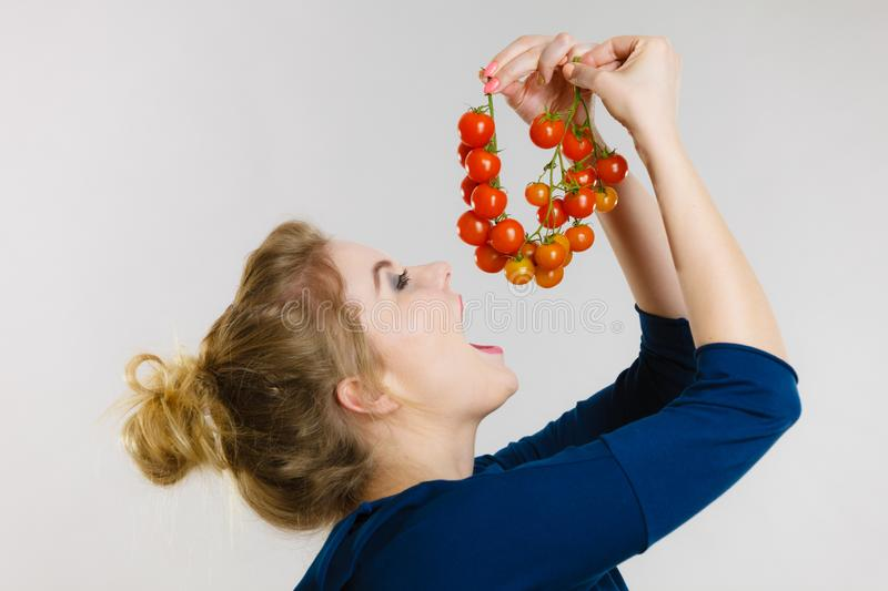 Woman holding fresh cherry tomatoes royalty free stock photos