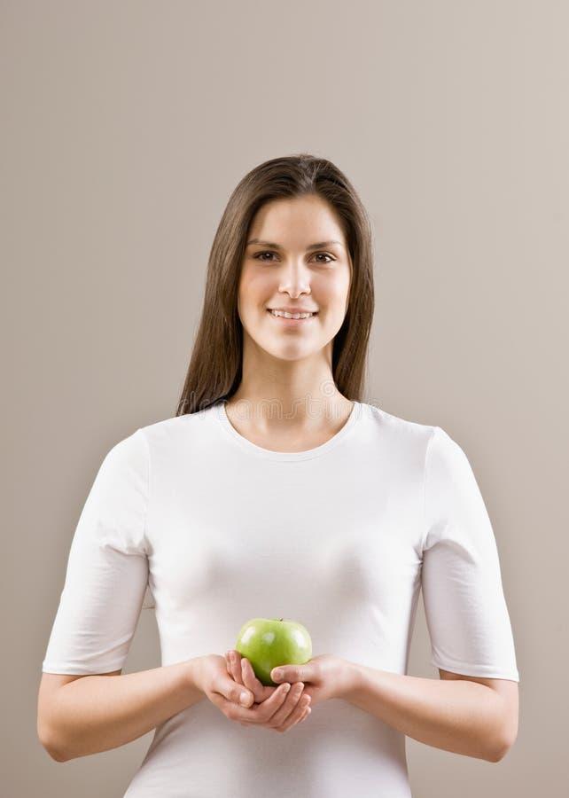 Woman Holding Fresh Green Apple Royalty Free Stock Photos