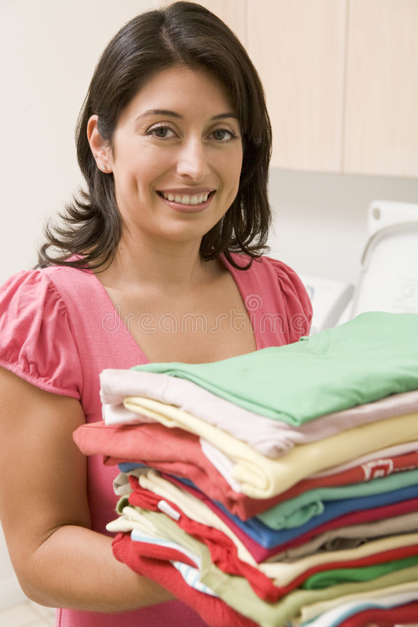 Woman Holding Fresh Laundry royalty free stock images