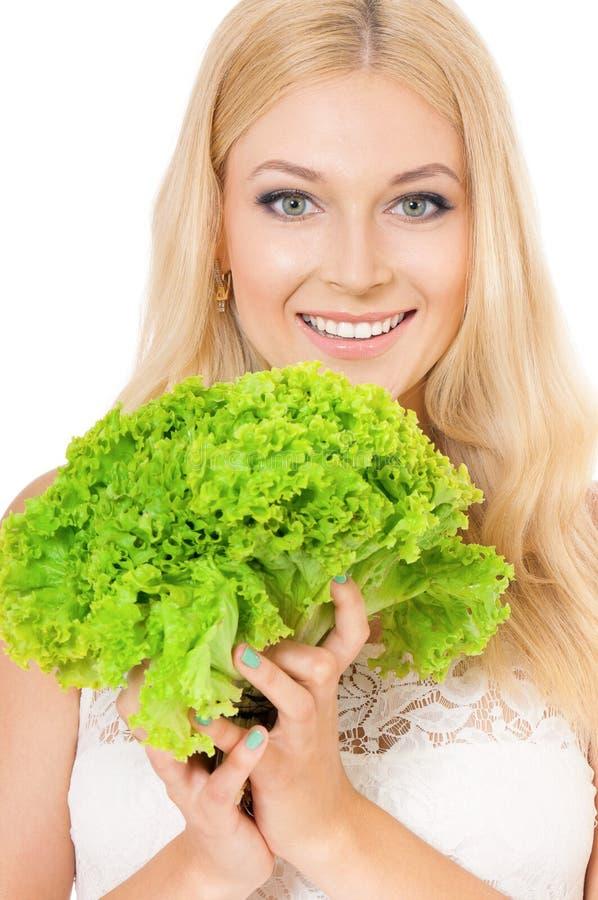 Woman holding fresh lettuce royalty free stock photos
