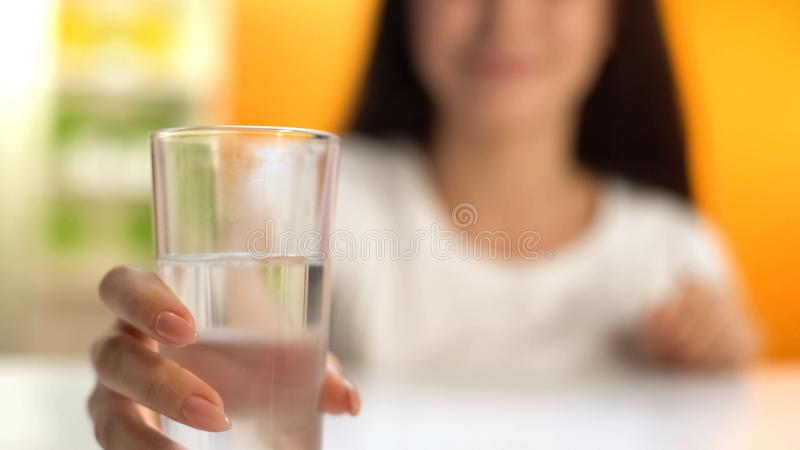 Woman holding fresh water, body hydration, beverage for weight loss, refreshment. Stock photo royalty free stock images
