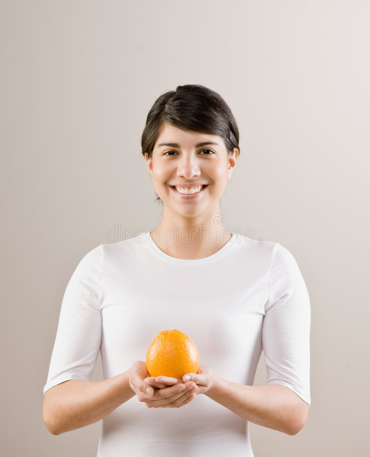 Woman holding fresh whole orange royalty free stock photos