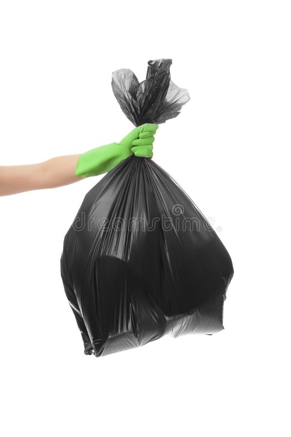 Woman holding garbage bag on white background royalty free stock photos