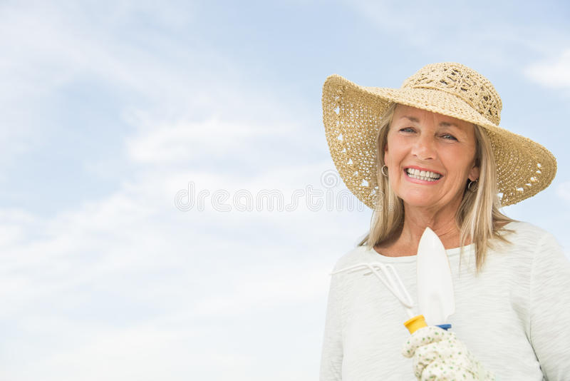 Download Woman Holding Gardening Equipment Against Sky Stock Image - Image: 34512055