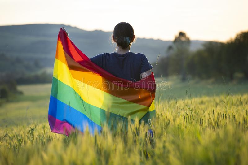 Young woman with LGBT flag royalty free stock image