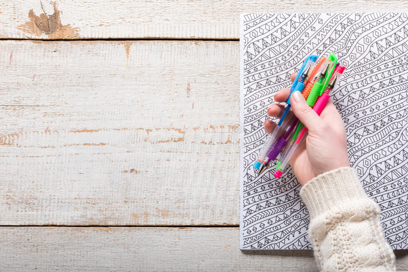 Woman holding gel pens, Adult coloring books, new stress relieving trend. Mindfulness concept royalty free stock image