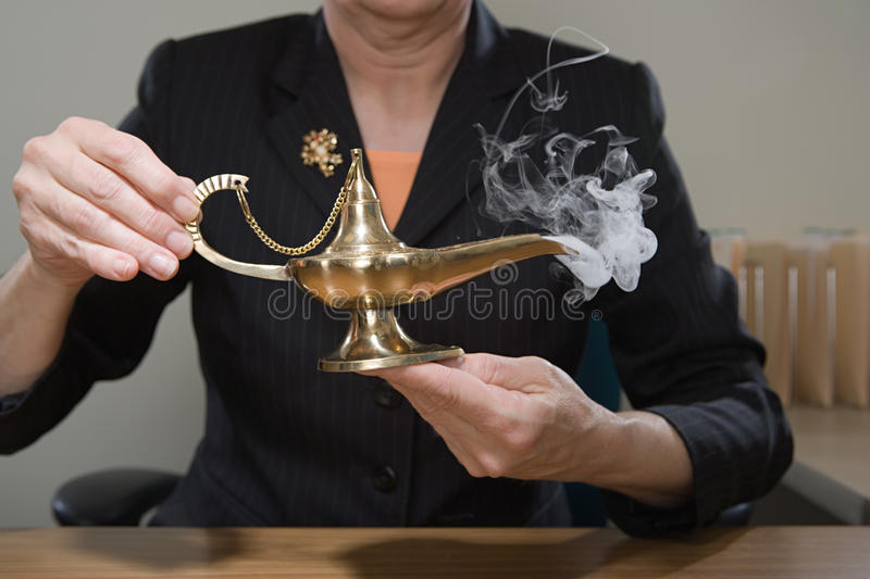 Woman holding genie lamp stock photo